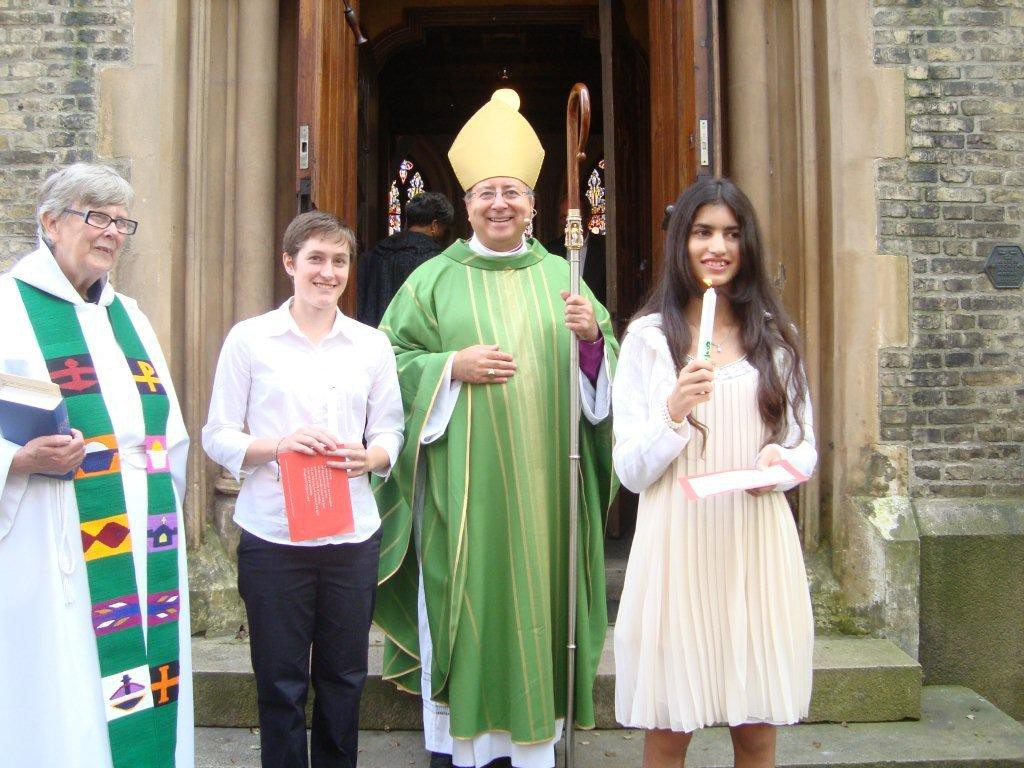 Bishop David with two Confirmation candidates after the service in 2011-